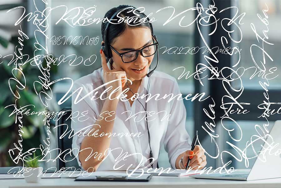 picture of a woman sitting at a desk with headphones on listening to a recording in a different language and then translating it to another language